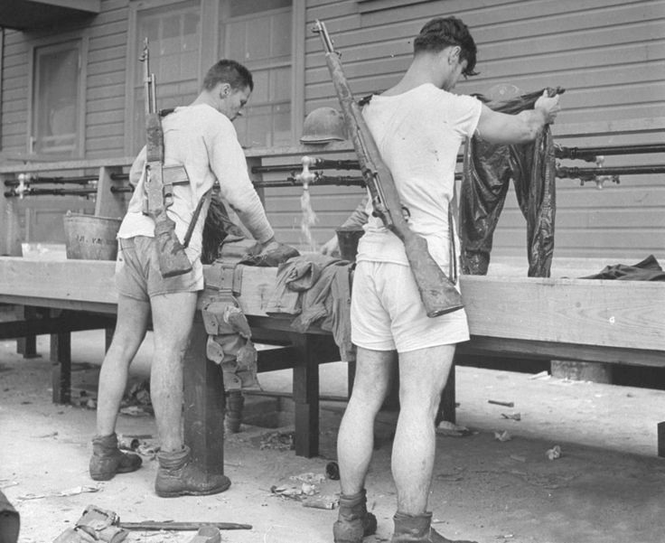 Marines in skivvies washing gear